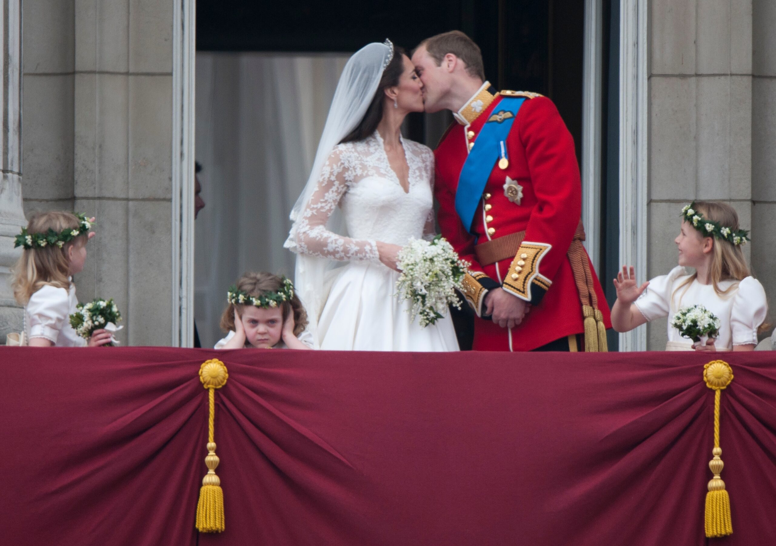Prince William and his wife Kate Middleton, who has been given the title of The Duchess of Cambridge, on the balcony of Buckingham Palace, London with  bridesmaids Margarita Armstrong-Jones (right) and Grace Van Cutsem (middle) and Lady Louise (left), following their wedding at Westminster Abbey.