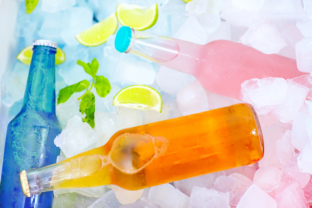chilled colorful wine coolers in ice box