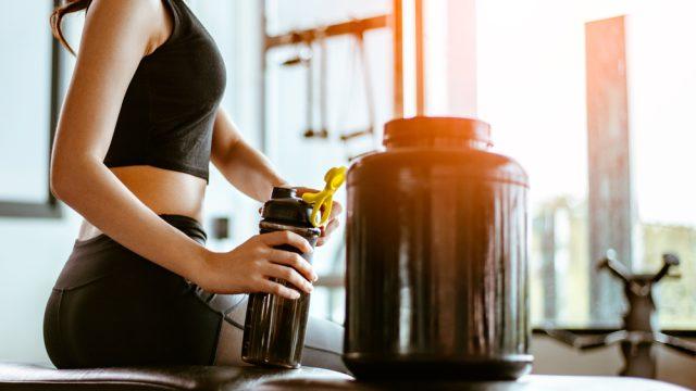 Woman adding supplement to water bottle deterenol bad