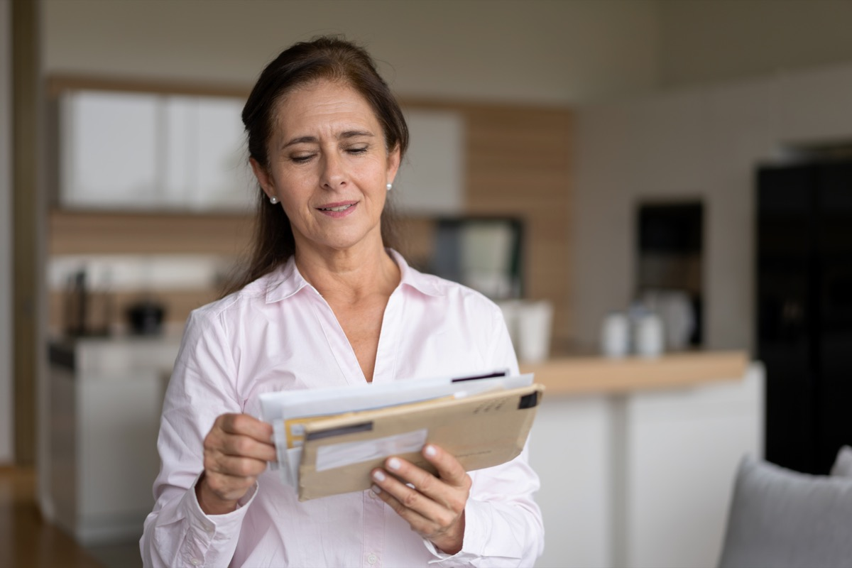 woman at home checking her mail - Lifestyles
