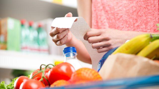 Woman checking receipt toilet paper price increase