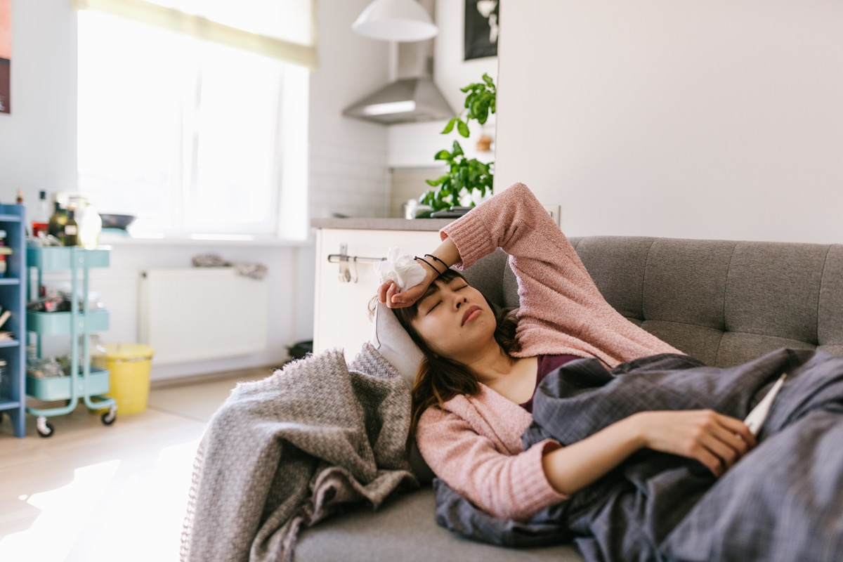 woman sick at home with high fever