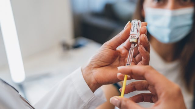 Doctor's hands Preparing injection with covid-19 vaccine