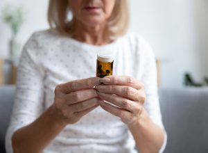 an older woman looking at medicine