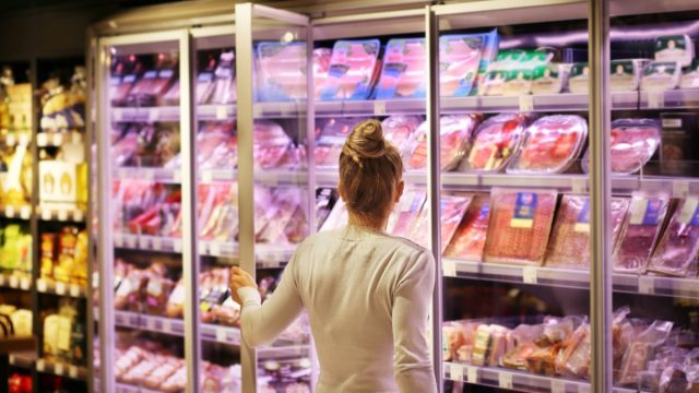 woman opening deli meat or cold cut case at grocery store
