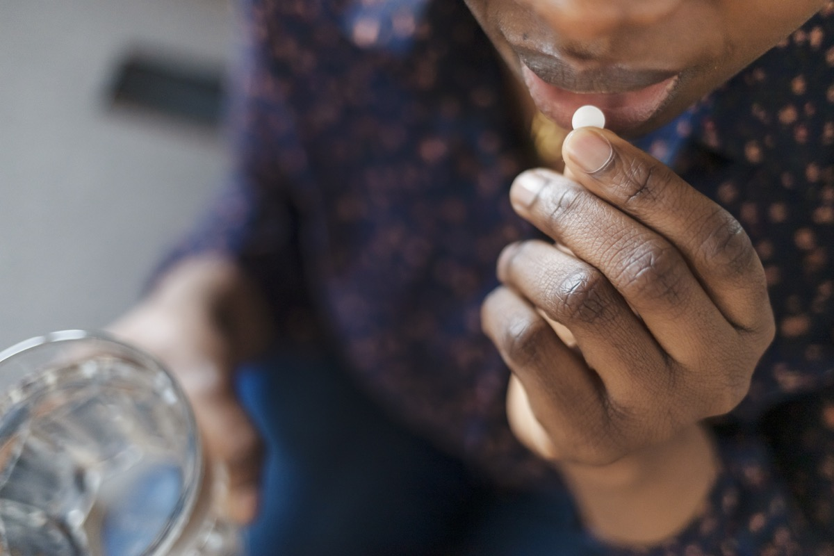 Woman Taking Pill, Supplements or Antibiotic, Female Preparing to Take Emergency Medicine, Chronic Disease, Healthcare and Treatment Concept. Closeup