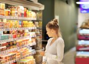 young woman shopping for groceries in dairy case
