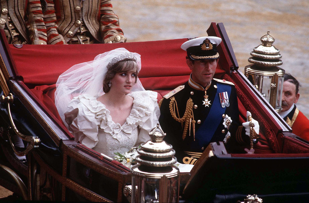 Princess Diana and Prince Charles riding in a carriage following their wedding in 1981