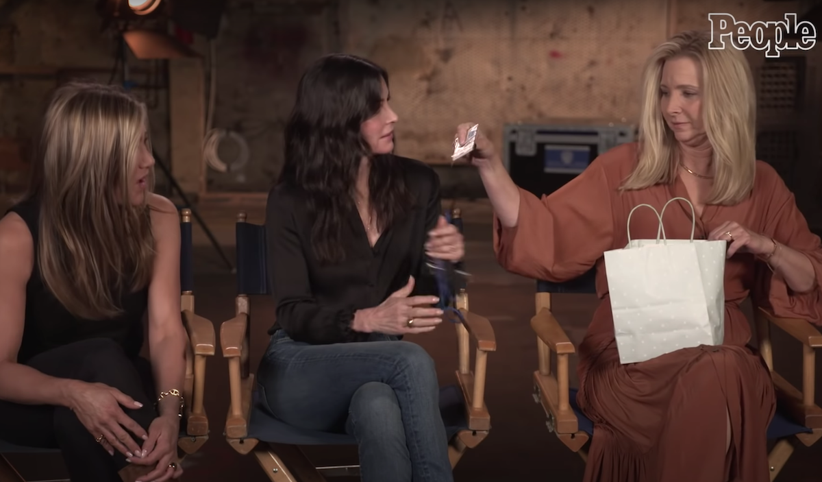 """Jennifer Aniston, Courtney Cox, and Lisa Kudrow being interviewed by """"People"""""""