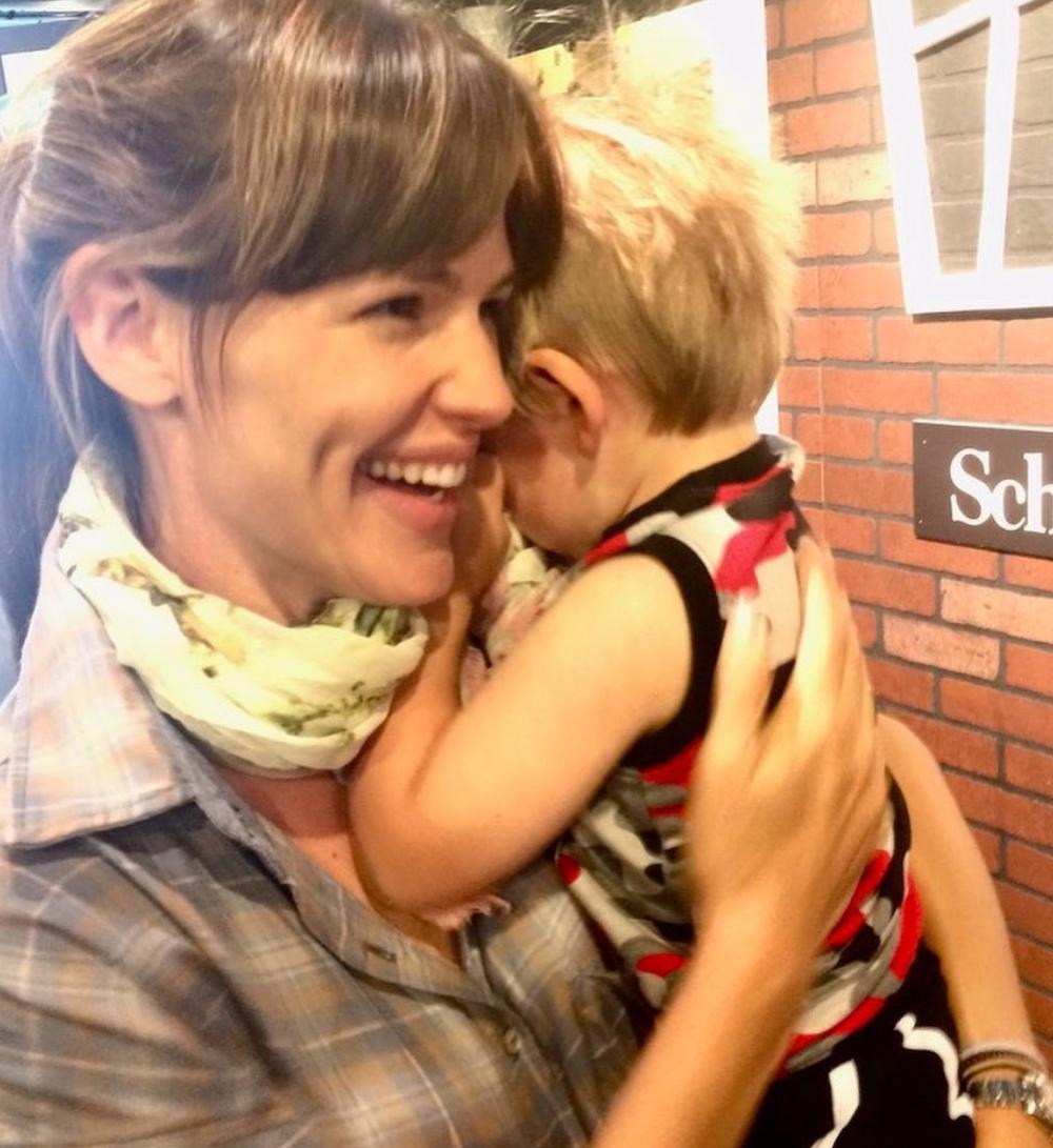 Jennifer Garner holding one of her children