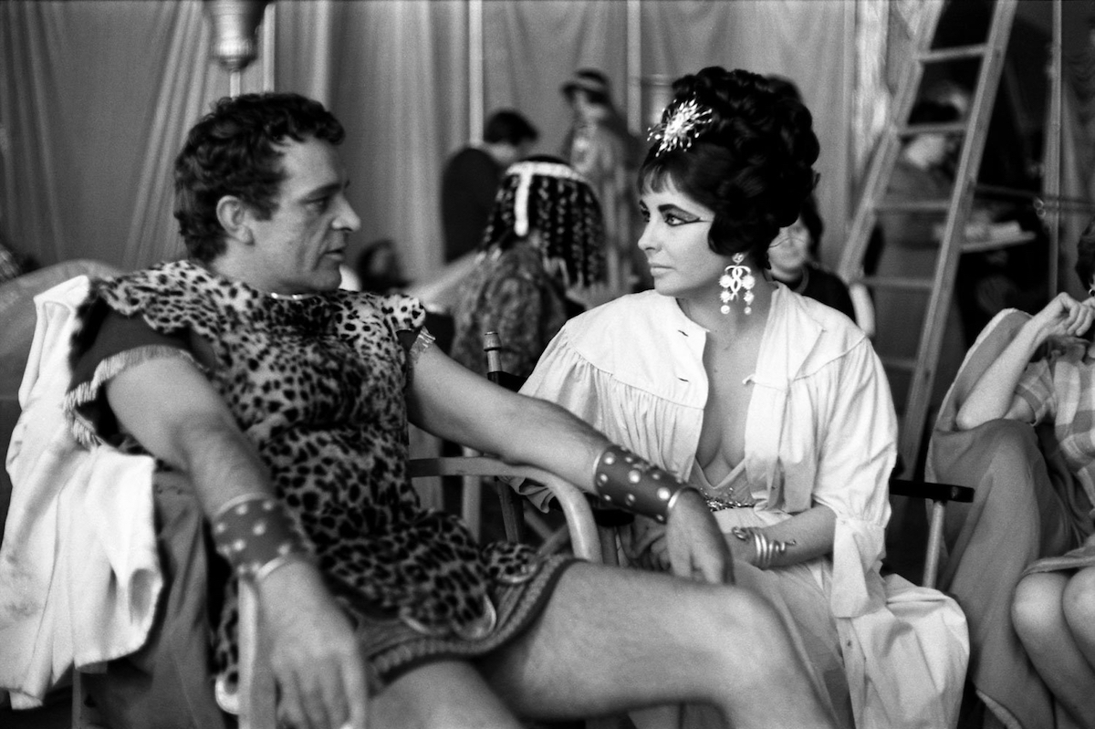 """Richard Burton and Elizabeth Taylor on the set of """"Cleopatra"""" in 1962"""