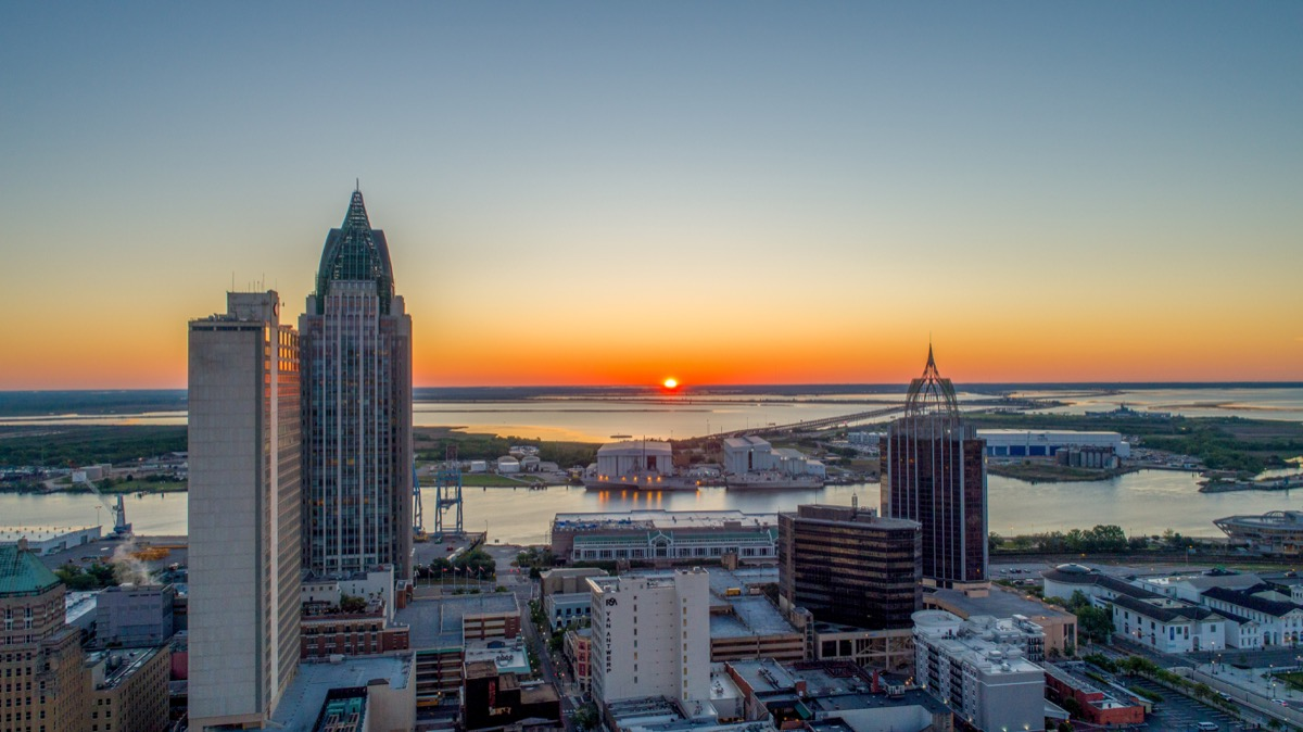Aerial view of downtown Mobile, Alabama urban waterfront at sunrise