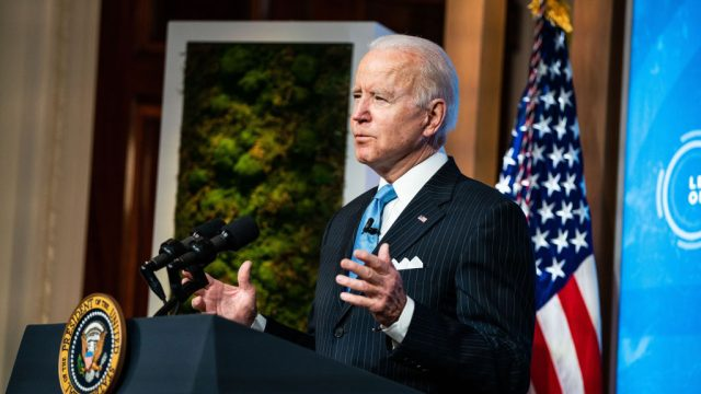 President Joe Biden standing at a podium and delivering a speech