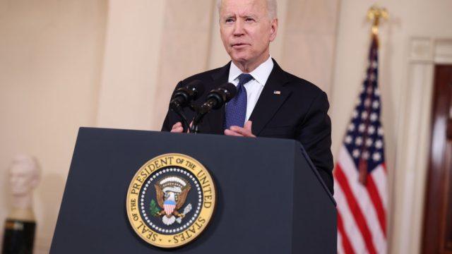 President Joe Biden speaking at a podium
