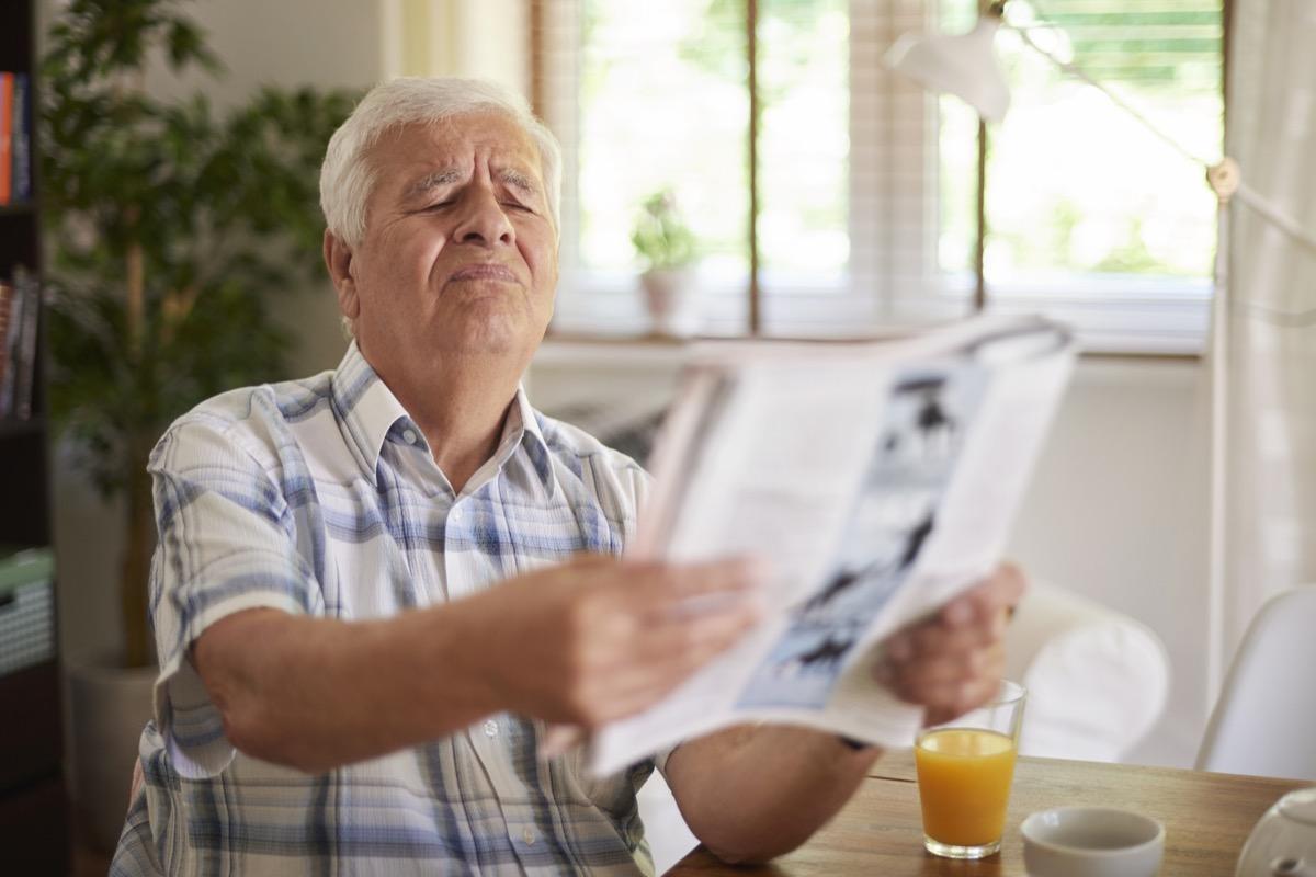 man struggling with blurry vision, bad eyesight