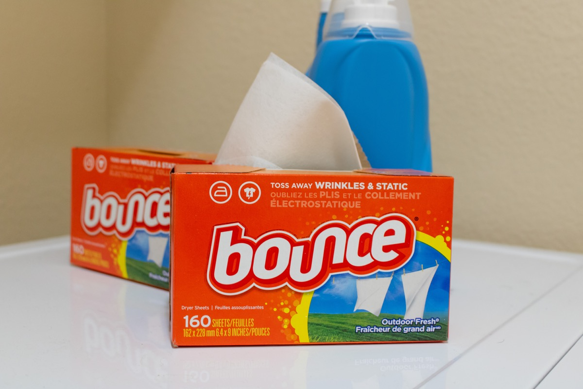 two boxes of bounce dryer sheets next to laundry detergent