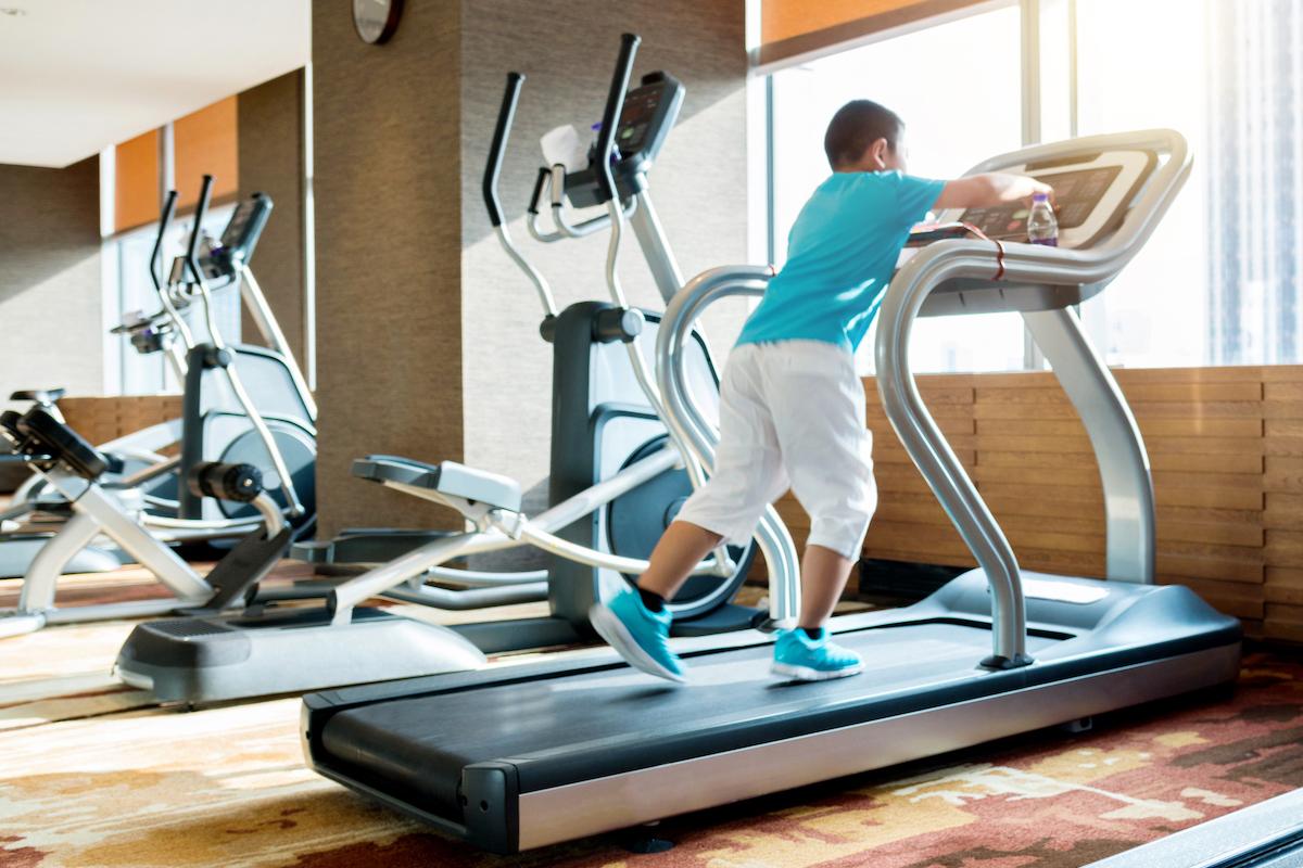 Little boy running on a treadmill