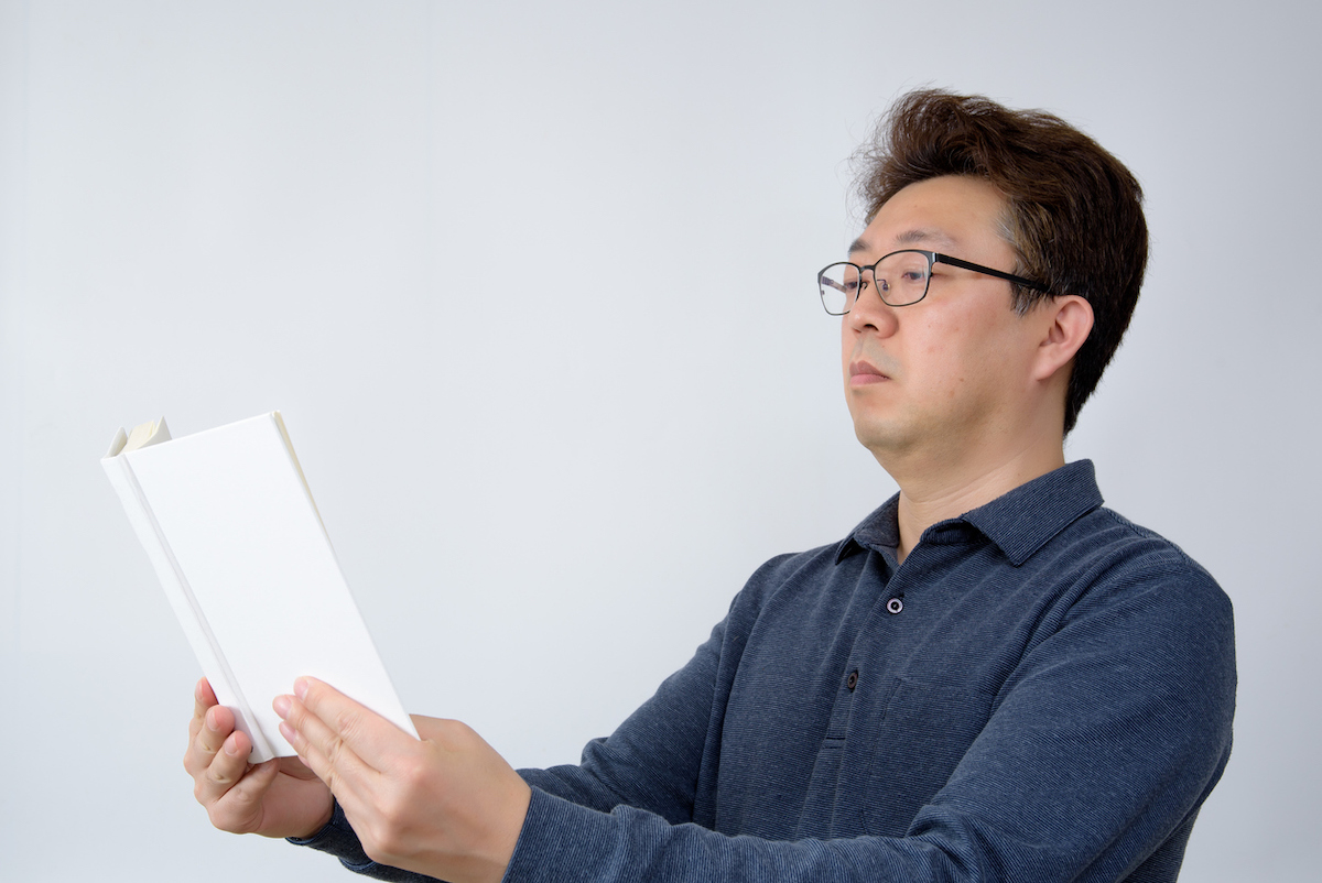 Man trying to read something