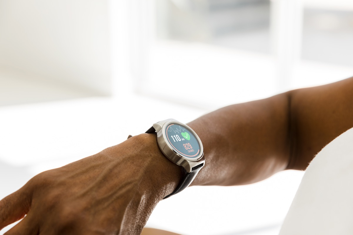 woman checks her heart rate and other activity levels on her smart watch.