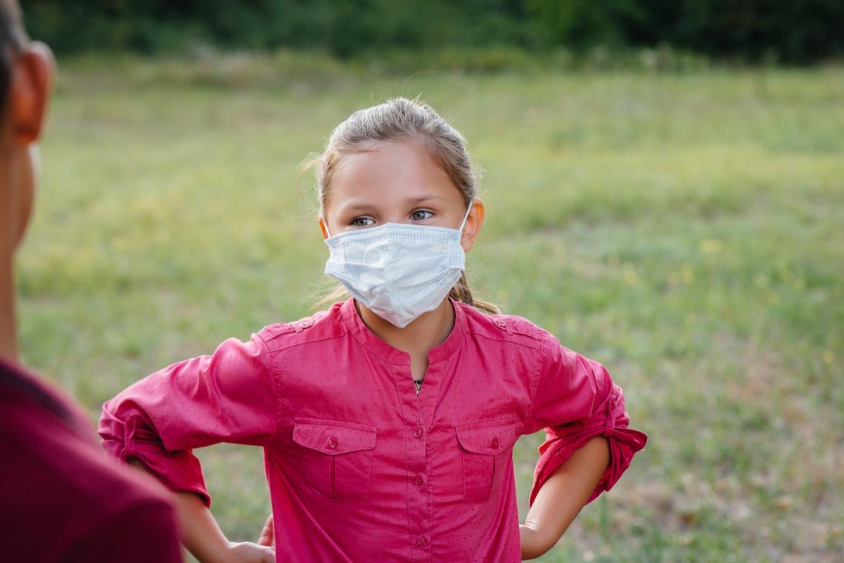Kid outside in mask