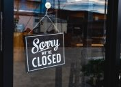 sorry we're closed sign in store window
