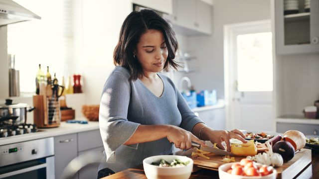 Shot of a woman cooking dinner at home