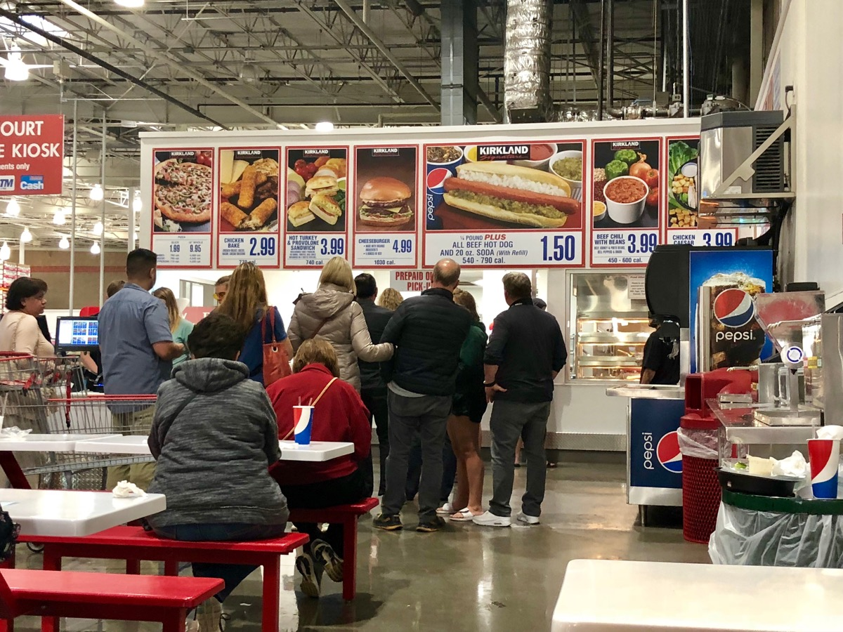 FOLSOM, CA, USA - OCT 8, 2018: Costco food court by the new self serve kiosk full of customers .