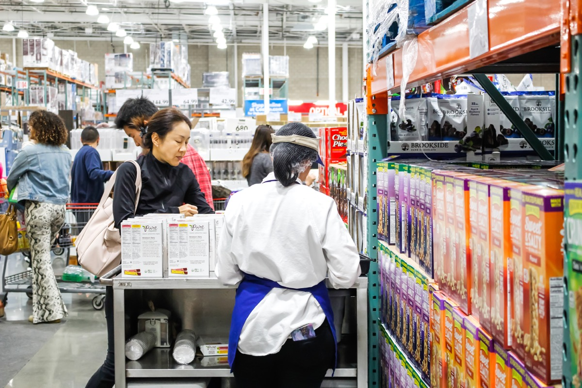 Tustin, California/United States - 02/08/2020: A view of the back of a female employee offering samples at a local Costco.