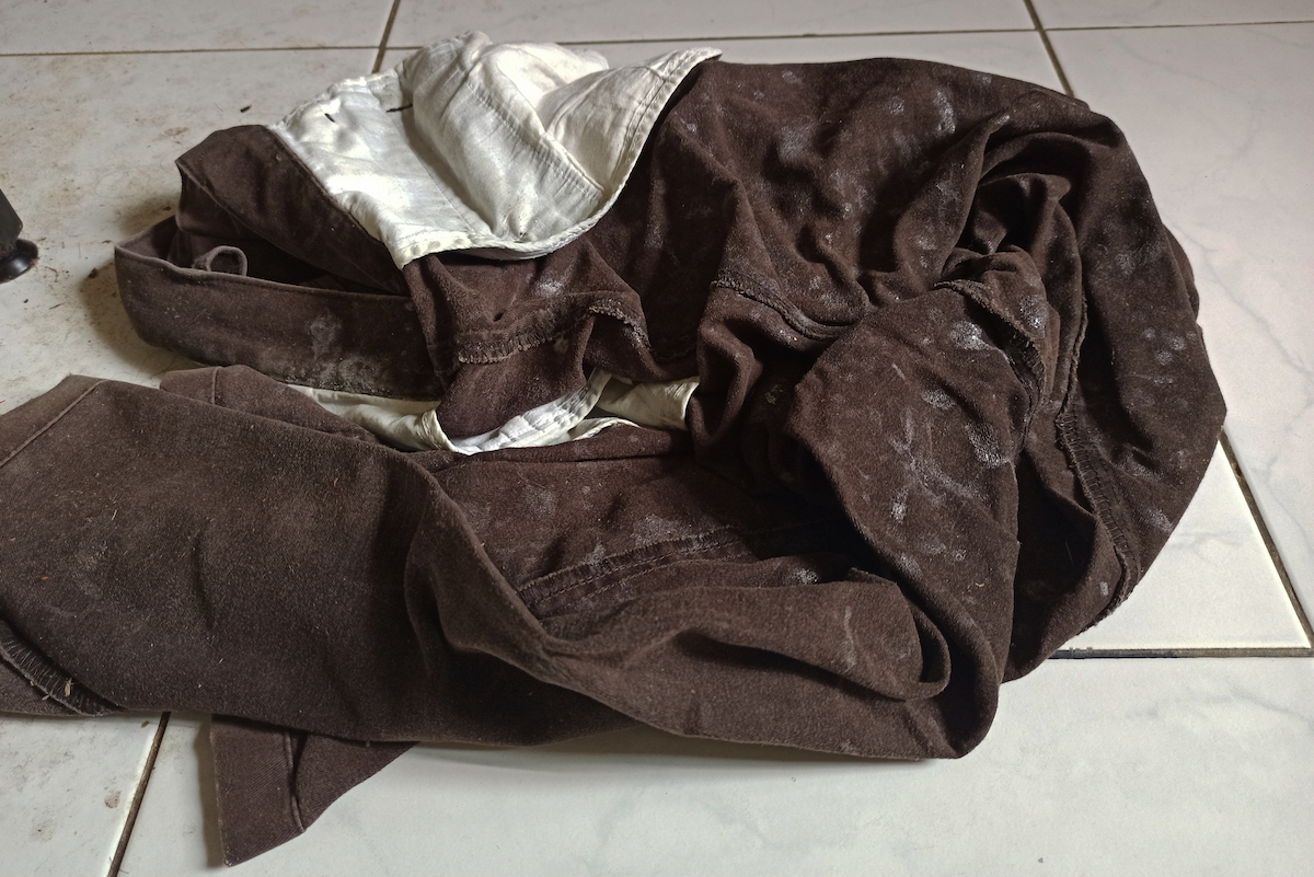 Selective focus image of dirty trousers on the floor