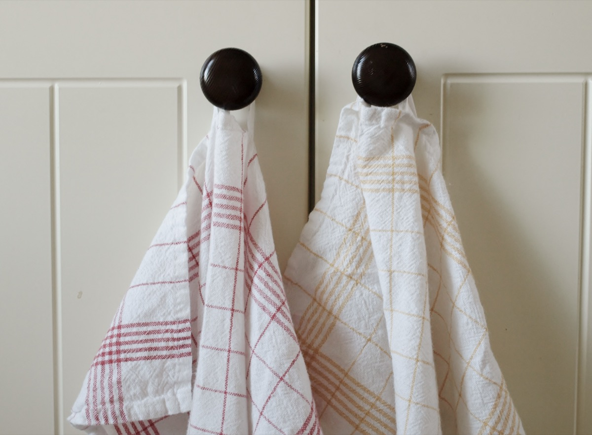 Kitchen towels hang on the button