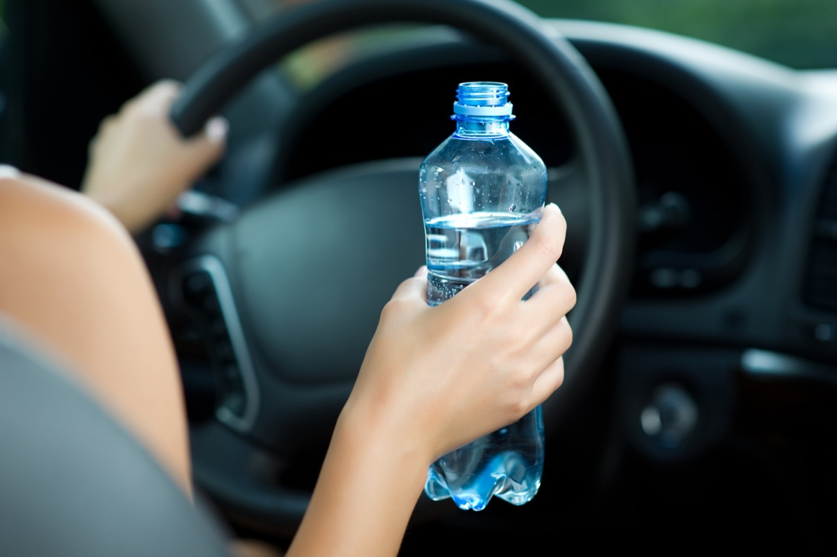 drinking water while driving car