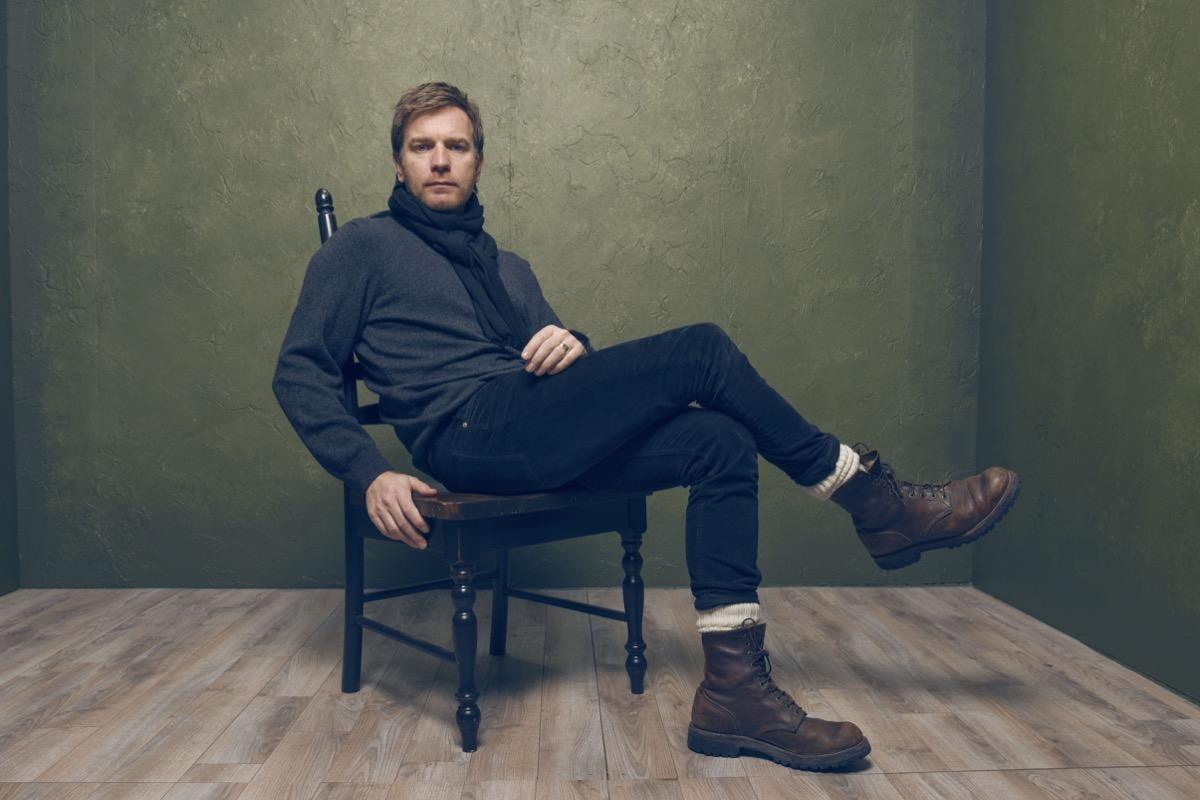 ewan mcgregor sitting in a chair