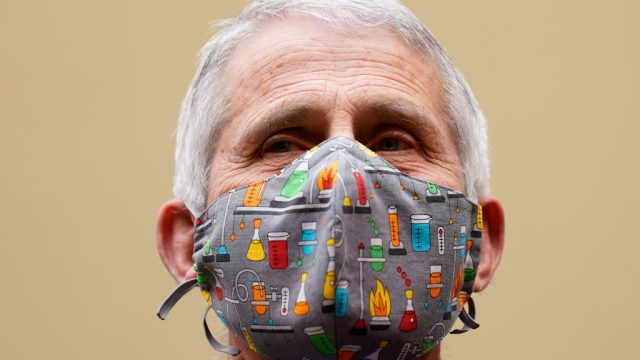 Dr. Anthony Fauci wearing a face mask with lab equipment depicted on it