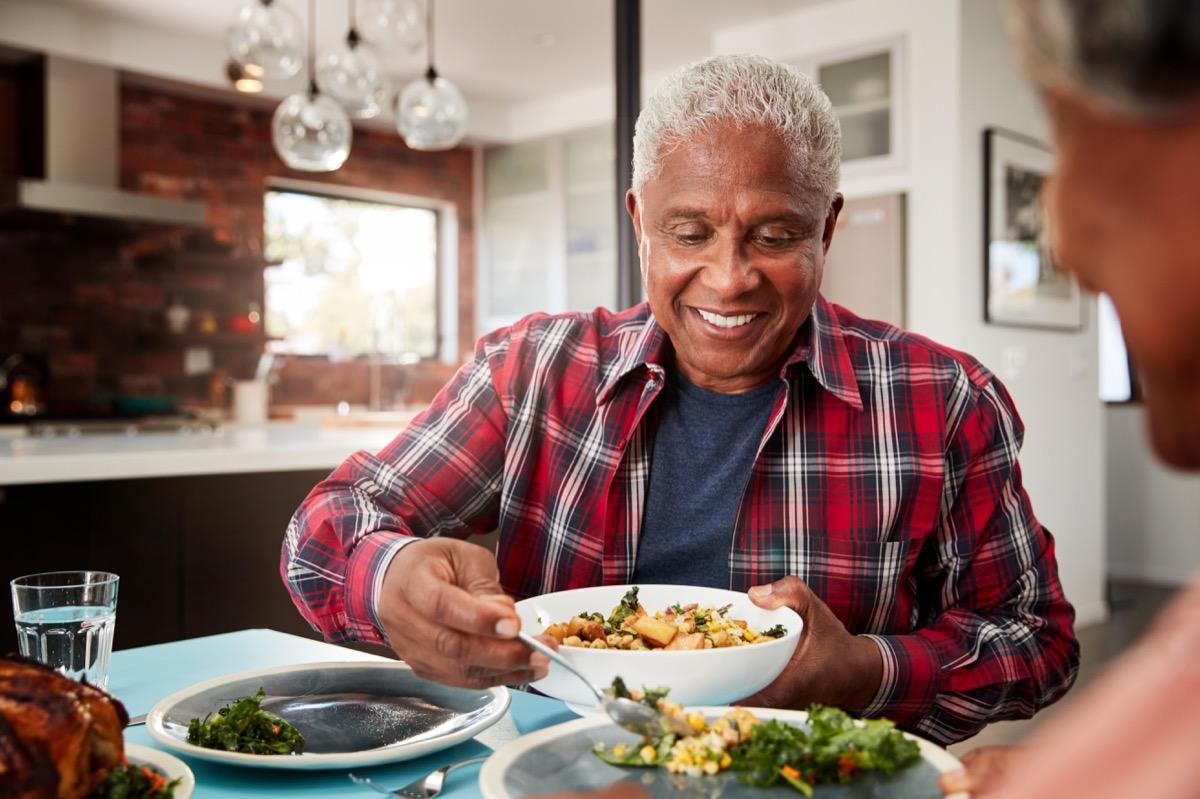 Older man eating dinner