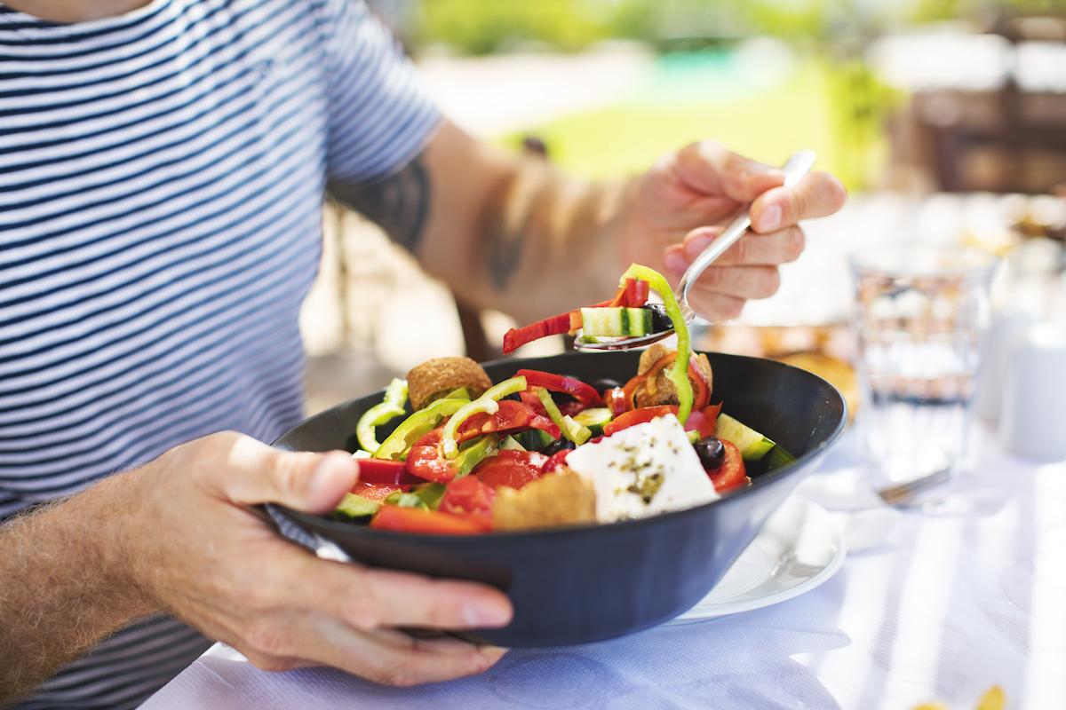 Man eating Greek Salad