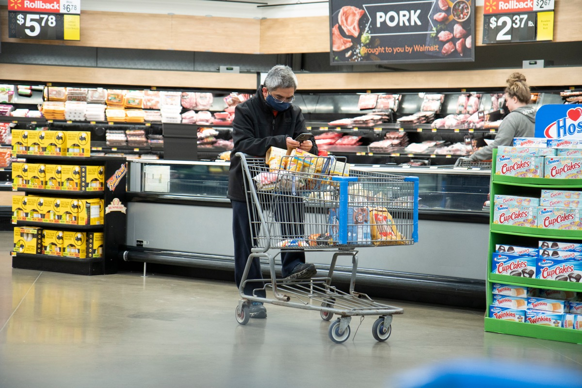 Illinois, United States, - April 10th 2020: A Walmart customer ina face mask attempting to get groceries during the pandemic.