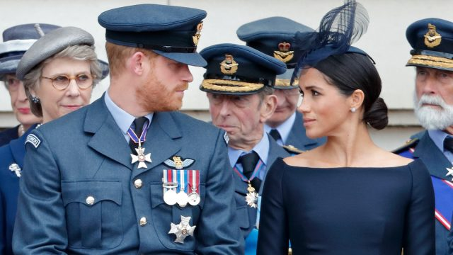 Prince Harry, Duke of Sussex and Meghan, Duchess of Sussex attend a ceremony to mark the centenary of the Royal Air Force on the forecourt of Buckingham Palace on July 10, 2018 in London, England