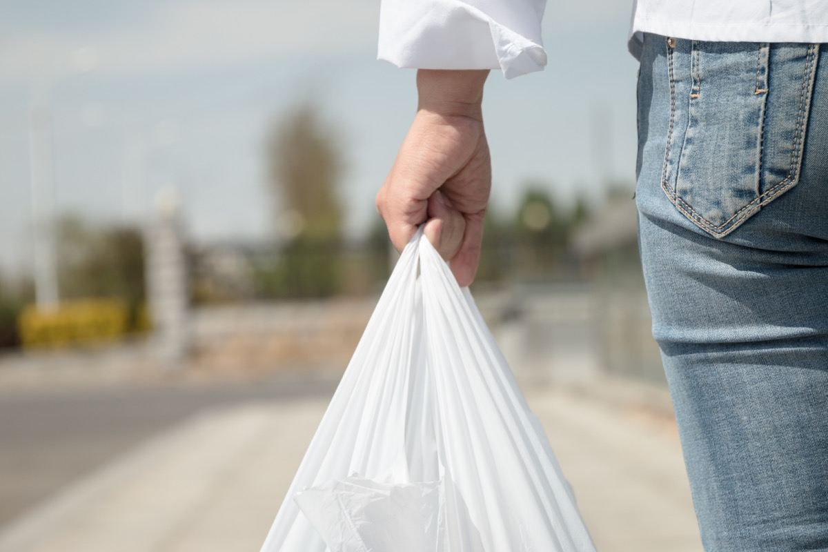 person holding plastic bag outside