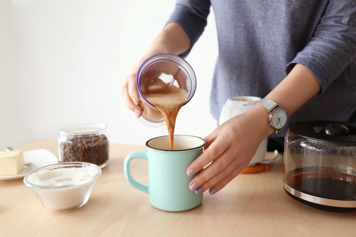 person making bulletproof coffee
