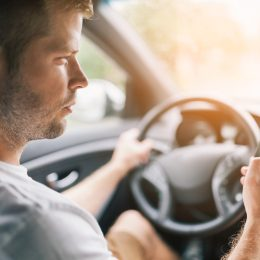 Driver using his mobile phone whilst driving a car