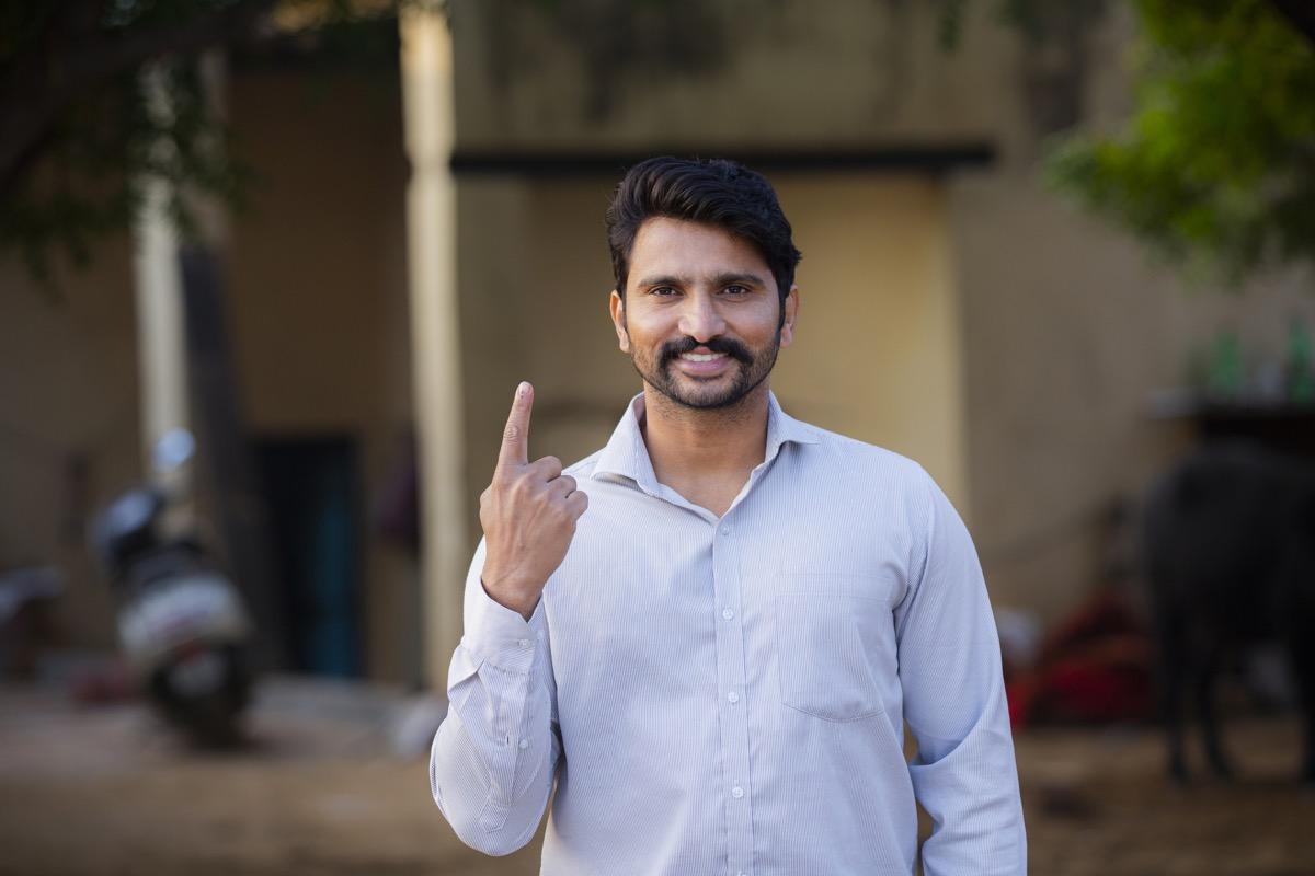 man holding up index finger
