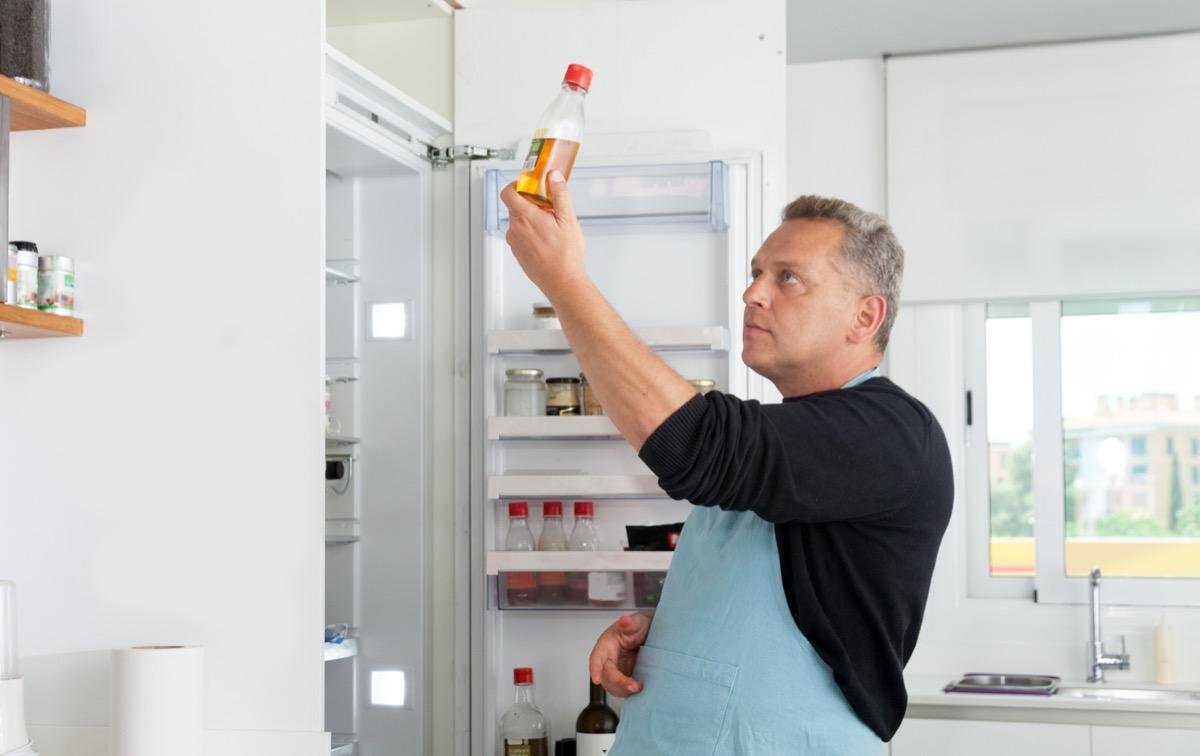 Chef opening refrigerator door