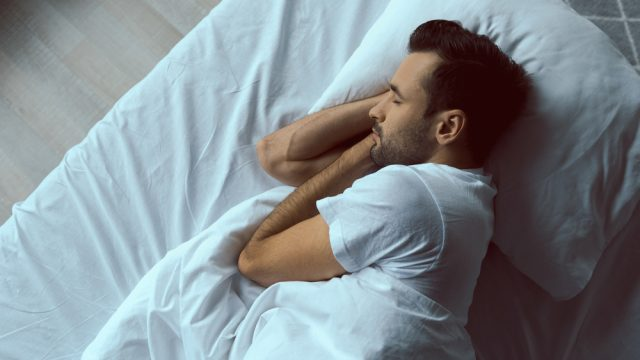 A man sleeping in bed