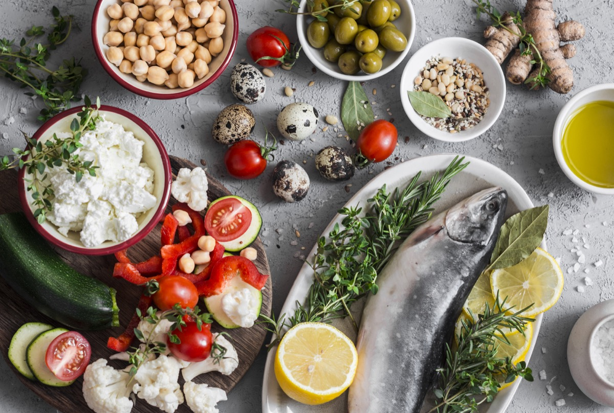 mediterranean diet, mediterranean style food on a table, fish, nuts, olives