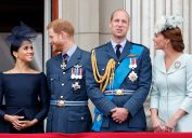Meghan, Duchess of Sussex, Prince Harry, Duke of Sussex, Prince William, Duke of Cambridge and Catherine, Duchess of Cambridge watch a flypast to mark the centenary of the Royal Air Force from the balcony of Buckingham Palace on July 10, 2018 in London, England.