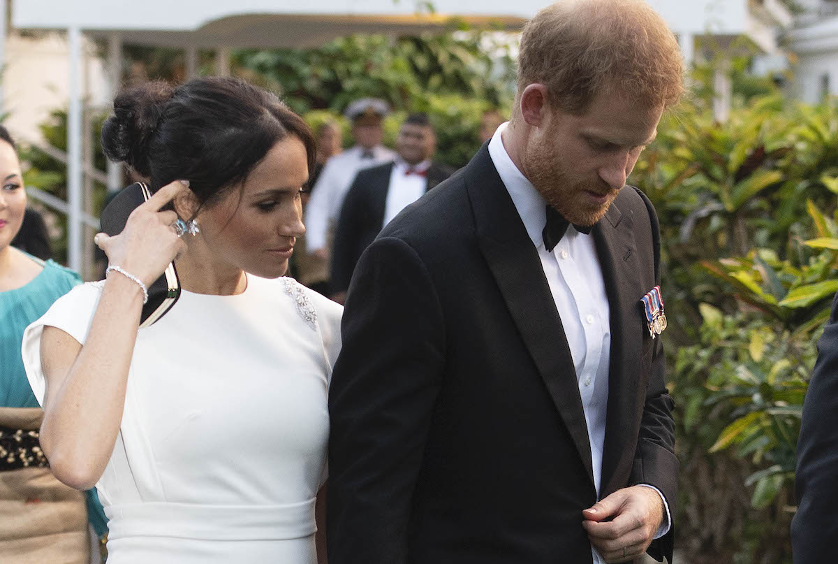 Prince Harry, Duke of Sussex and Meghan, Duchess of Sussex attend a state dinner at the Royal Residence on October 25, 2018 in Nuku'alofa, Tonga. She wears Diana's aquamarine ring.