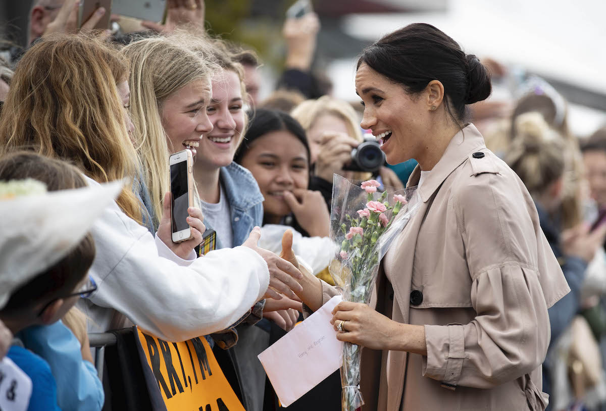 The Duke and Duchess of Sussex meet fans during a public walk along Auckland's Viaduct Harbour during their visit to New Zealand.