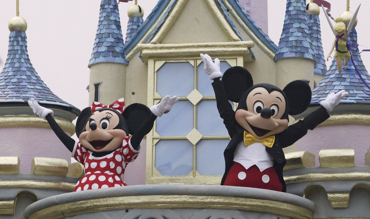 mickey and minnie mouse with hands up