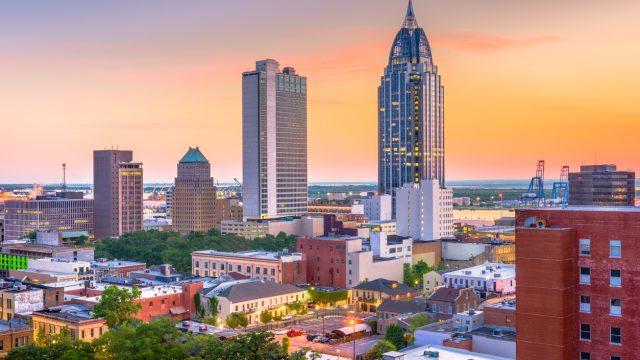 The skyline of Mobile, Alabama at dusk