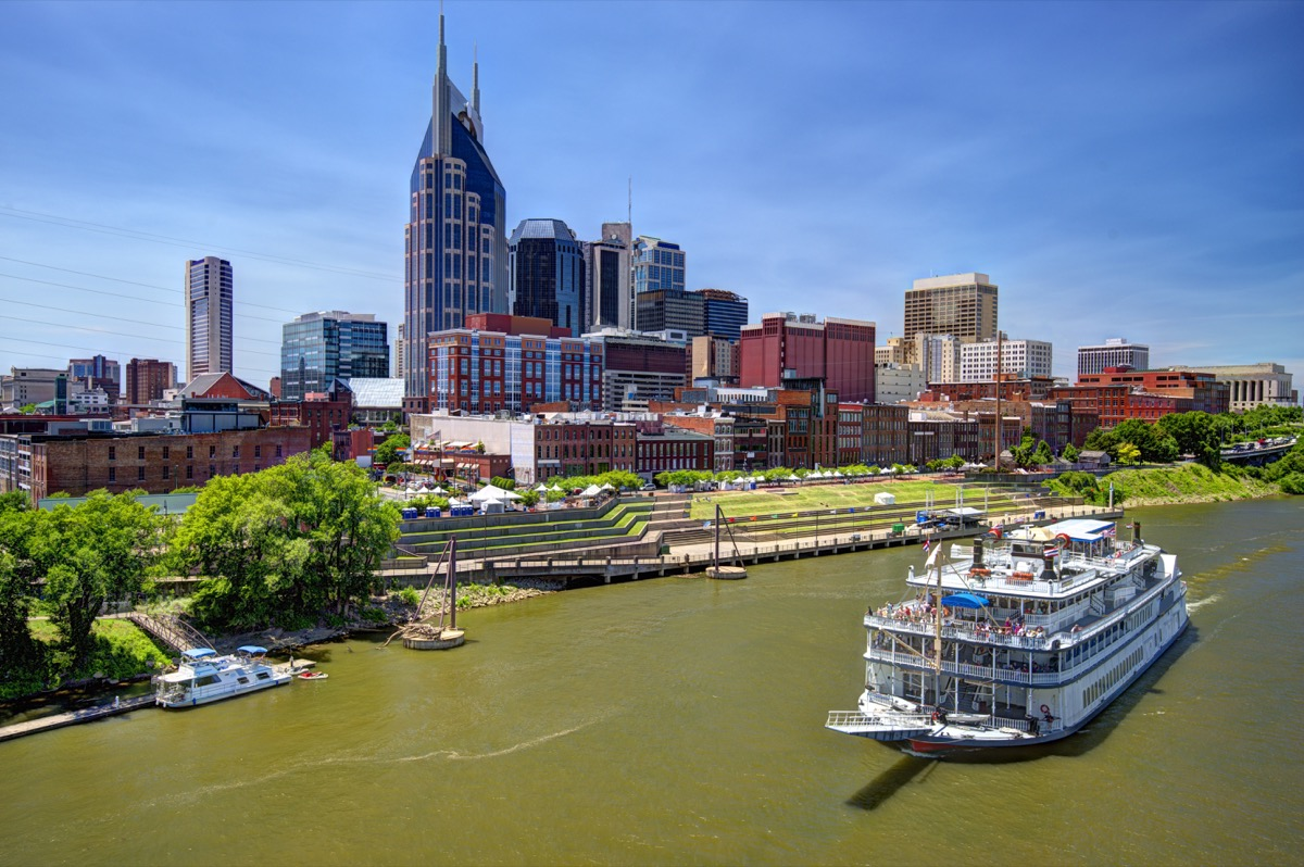 skyline in downtown tennessee, nashville, river, boat